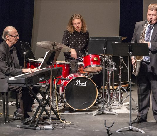 SE music professor Gregory Dewhirst plays the saxophone while simultaneously directing both SE's Jazz Ensemble and Jazz Combo throughout the recital Jazz Greats Oct. 11 on SE.