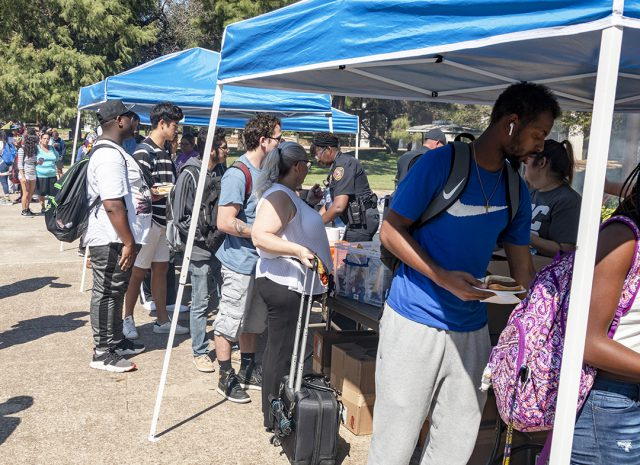South students, faculty and staff line up for free food served by officers during Cookout with the Cops on South Campus. The event was used to promote communication and familiarization with campus officers.