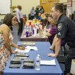 NW student Lydia Pena talks to Benbrook Police Department Detective W. Beverly about employment opportunities Oct. 4 on NW Campus.