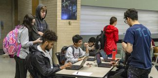 NW students play a game called LightBot on laptops that introduces them to basic programming logic at Candy and Coding Oct. 9 on NW Campus.