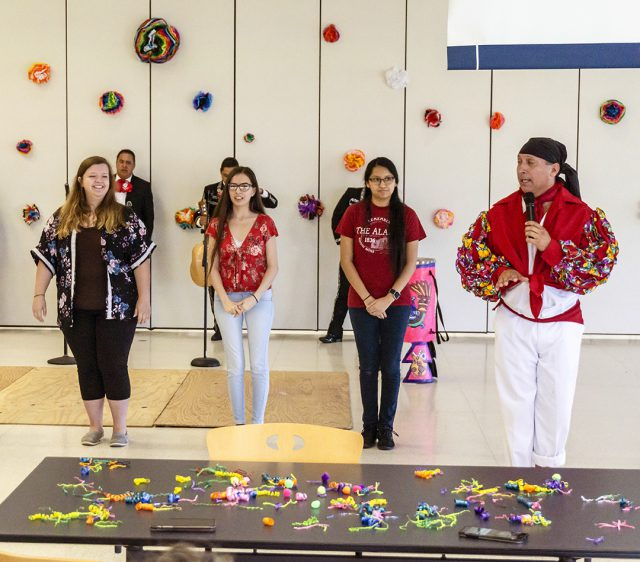 NW students Julia Antio, Alyssa Begay and Ishtar Carrasquillo learn to salsa Oct. 4 on NW.
