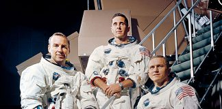 James Lovell Jr., William Anders and Frank Borman, members of the Apollo 8 crew, pose for a photo in their space suits on a Kennedy Space Center simulator Nov. 22, 1968. Apollo 8 was the U.S.' second manned spaceflight and the first to reach Earth's moon.