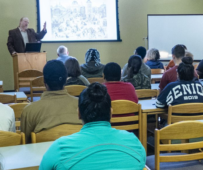 SE history assistant professor Mike Downs explains the history of the transition of Renaissance beliefs of magic to science Oct. 23 in the Library Classroom on SE Campus.
