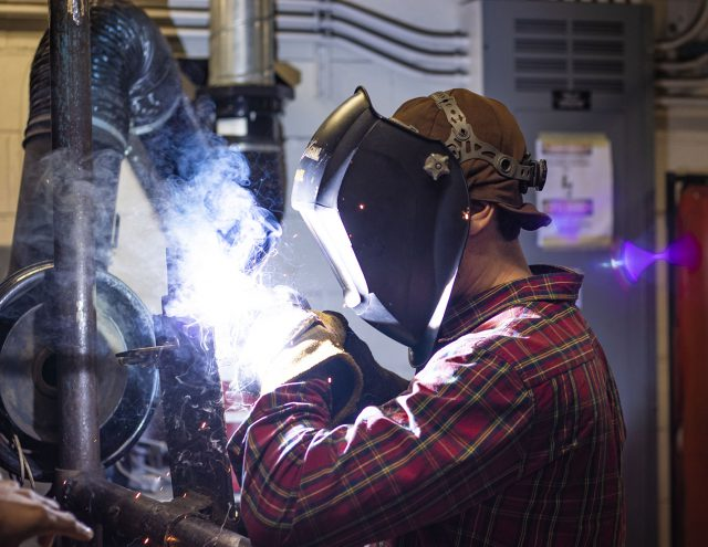 South student Stewart Fetzik concentrates on the flux-cored arc welding process he is learning about in his Intro to Pipe class Nov. 12. Intro to Pipe is one of 10 welding classes offered at South Campus.