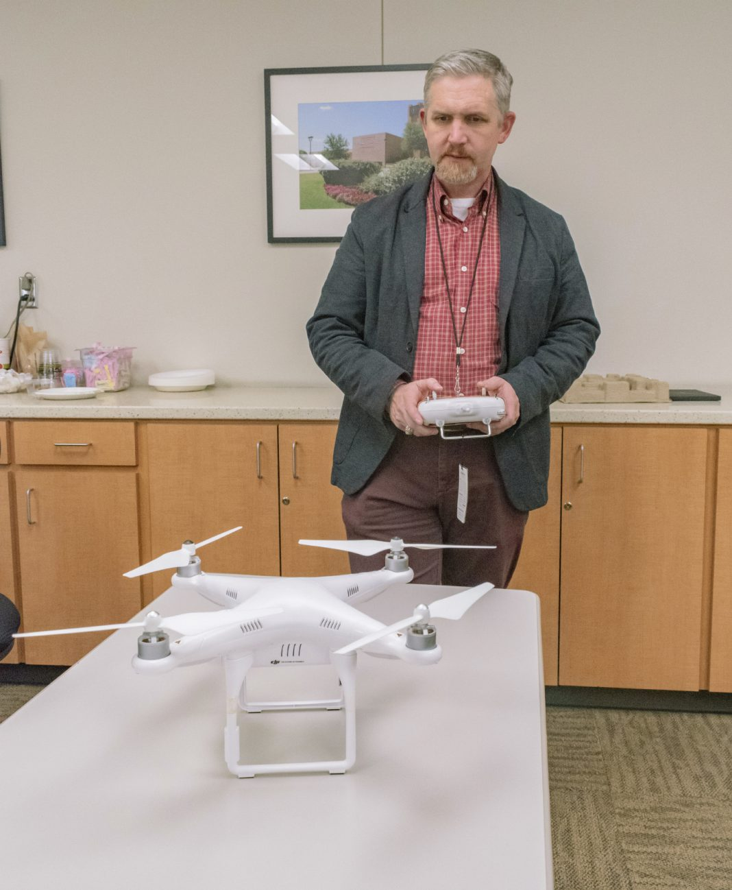 NE special projects coordinator Harry Johnson demonstrates how to operate the Phantom 2 drone which is a part of the remote pilot certification test prep course, where students can learn about regulations for drone flying on the NE and NW Campuses.