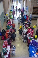 Clubs set up booths to entice students to join as they browse the various options at SE Campus' Club Expo event.