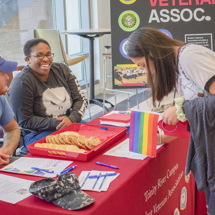TR Student Veteran Association speaks to students as they hand out cookies. The Club Crawl brought all the clubs together to bring in new members. Photo by Christian Garza/The Collegian