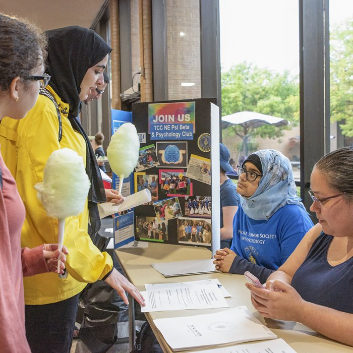 NE students Safiyyah Multani and Heather Rogan inform students about the Psi Beta and Psychology Club during the Club Rush. Photo by Joseph Serrata/The Collegian