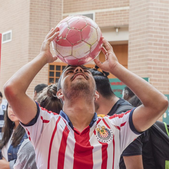 SE student Rafa Martinez practices his headers during the Club Expo as he advocates for the Soccer Club by showing off some of his skills.